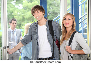 Students at college entrance