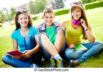 Students at leisure - Portrait of three college students...