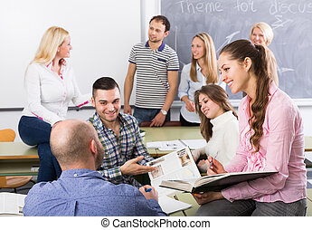 students chatting at training session for employees during...