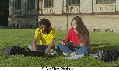 Students couple learning with digital devices at campus