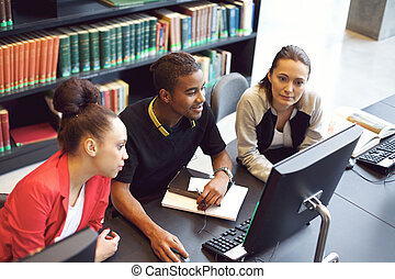 Students finding information on computer for school project