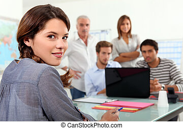 Students gathered around laptop in class