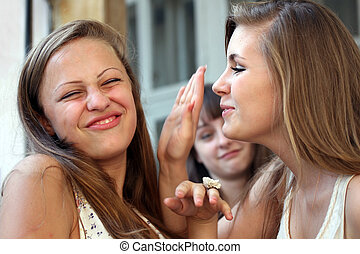 Students girls having conversation and laughing