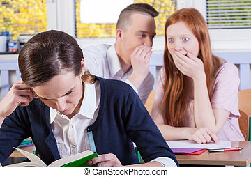 Students gossip on a lesson