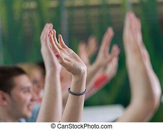 students group raise hands up on class - senior teacher ...