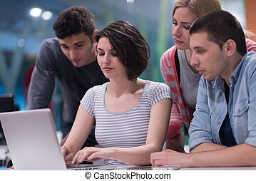 students group study together in school classroom and...