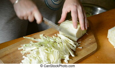 students hands cut up cabbage