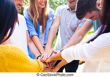 Students hands together