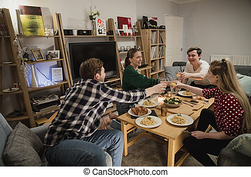 Students Having a Dinner Party