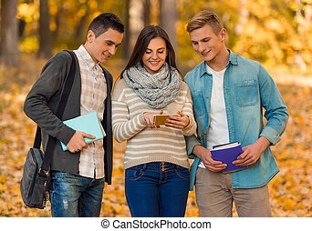 Students in autumn park