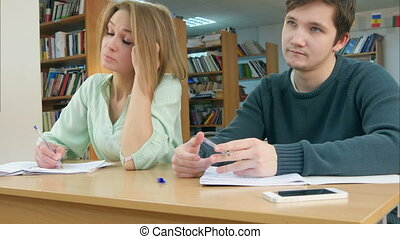 Students in class listening to a tutor