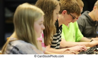 Students in school library - A group of students working &...