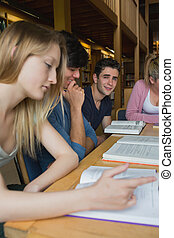 Students in the library in a study group