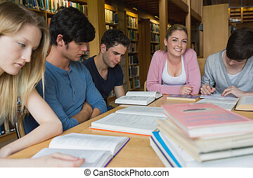 Students in the library studying together