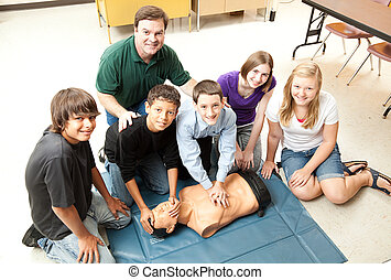 Students Learn CPR - A group of teenage students learning...