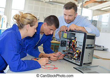 Students learning to repair computer