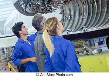 Students looking at aircraft internals