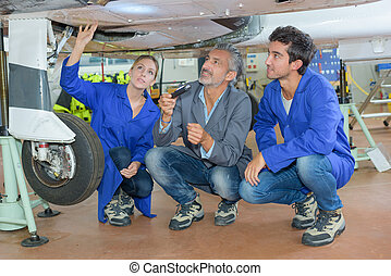 Students looking at aircraft undercarriage