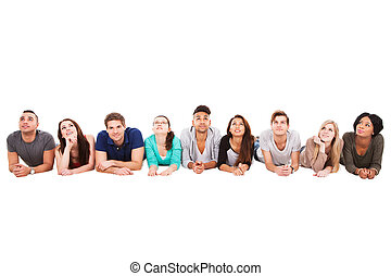 Students Lying In A Row Over White Background