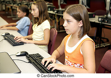 Students on Computers - Students in the school library doing...