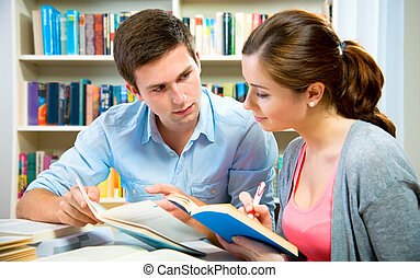 Students - couple of students in a library