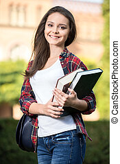 Students - Portrait of a young beautiful student with...