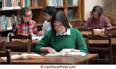 Students Prepare for Exam - Group of students preparing for...