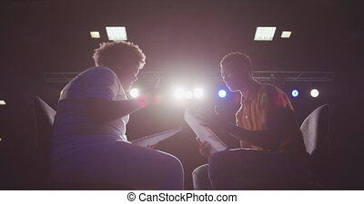 Students preparing before a high school performance in an ...