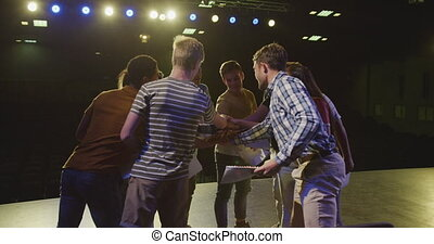 Students preparing before a high school performance with ...