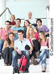 Students sat on school steps