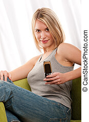 Students series - Blond teenage girl with mobile phone