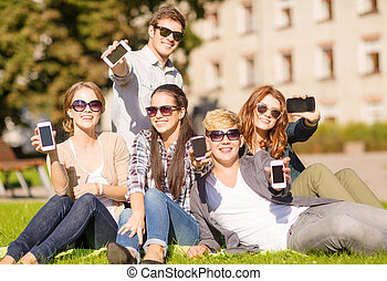 students showing smartphones - education, technology,...
