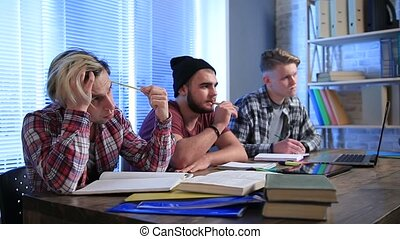 Students sitting in a lecture hall and studying