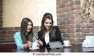 Students sitting in cafe smiling and study