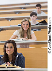 Students sitting looking and smiling