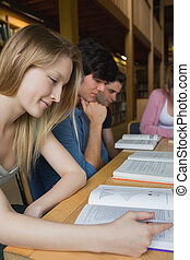 Students studying around library table