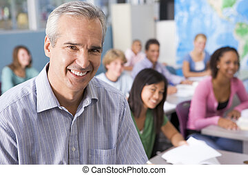 Students studying in geography class with teacher