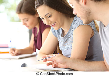 Students talking about class work at classroom