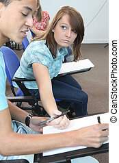 Students talking in a lecture room