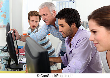 Students using computers in the classroom