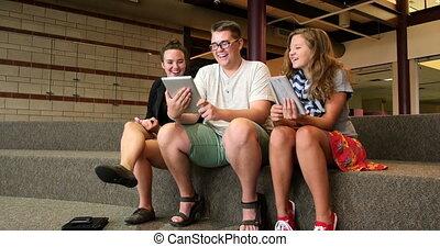 Students using newer technology UHD