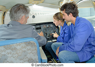 Students viewing aircraft cockpit