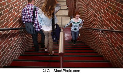 Students walking up and down the stairs