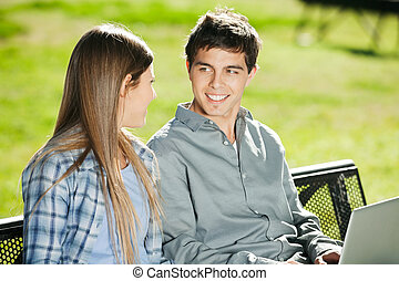 Students With Laptop Looking At Each Other In Campus