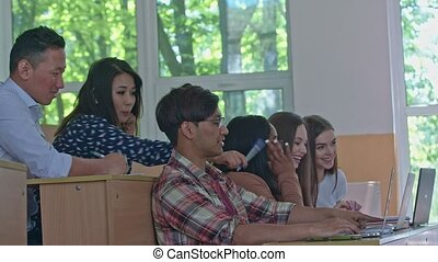 Students with laptops being in the university. - Students...