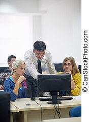 students with teacher  in computer lab classrom