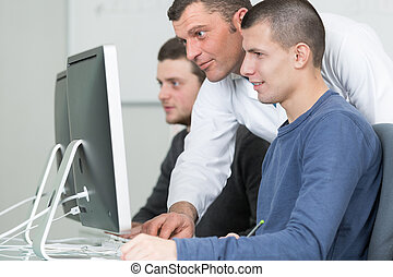 students with teacher studying modern technologies