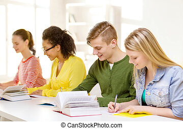 students with textbooks and books at school - education and...