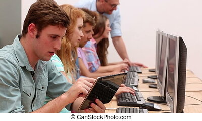 Students working in computer room w