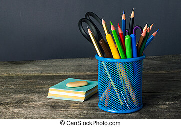 Studies accessories and supplies on the wooden table